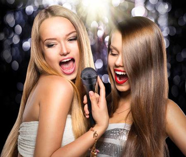33708788-karaoke-beauty-girls-with-a-microphone-singing-and-dancing
